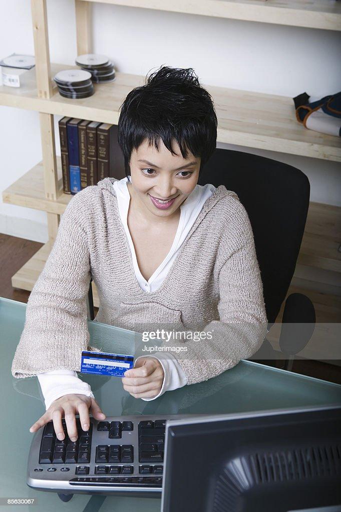 Woman shopping online : Stock Photo