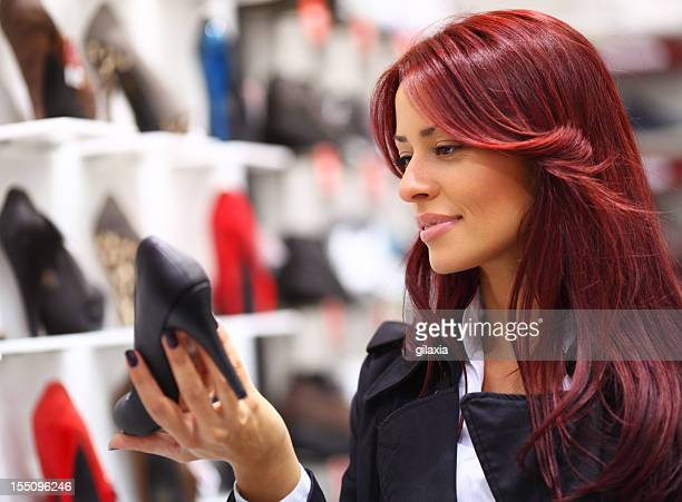 Woman shopping shoes.