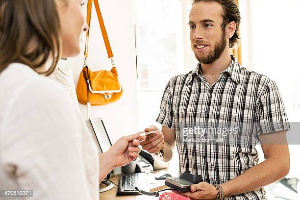 Woman shopping with credit card.