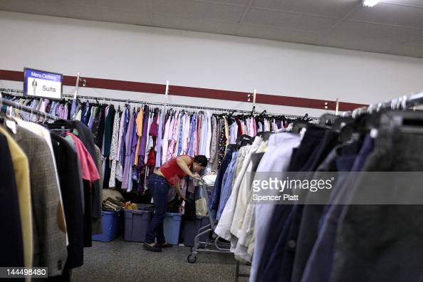 A woman shops at a Salvation Army thrift store on May 14 2012 in Utica New York Like many upstate New York communities Utica is struggling to make...