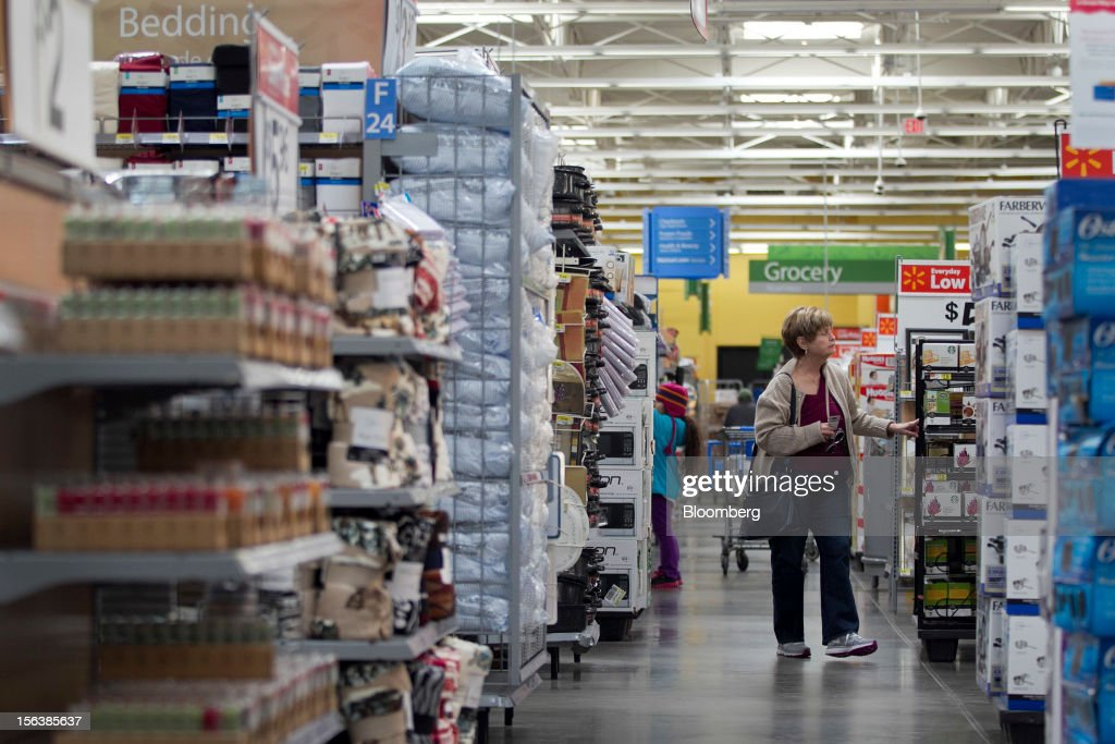 A woman shops at a Wal-Mart store in Alexandria, Virginia, U.S., on Wednesday, Nov. 14, 2012. Wal-Mart Stores Inc. is scheduled to release earnings data on Nov. 15. Photographer: Andrew Harrer/Bloomberg via Getty Images