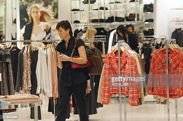 A woman shops at an outlet of the fashion chain Zara in Hong Kong 29 November 2004 Retail sales in Hong Kong a barometer of the health of the economy...