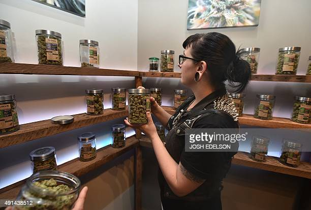 A woman shops at Oregon's Finest a marijuana dispensary in Portland Oregon on October 4 2015 As of October 1 2015 limited amounts of recreational...