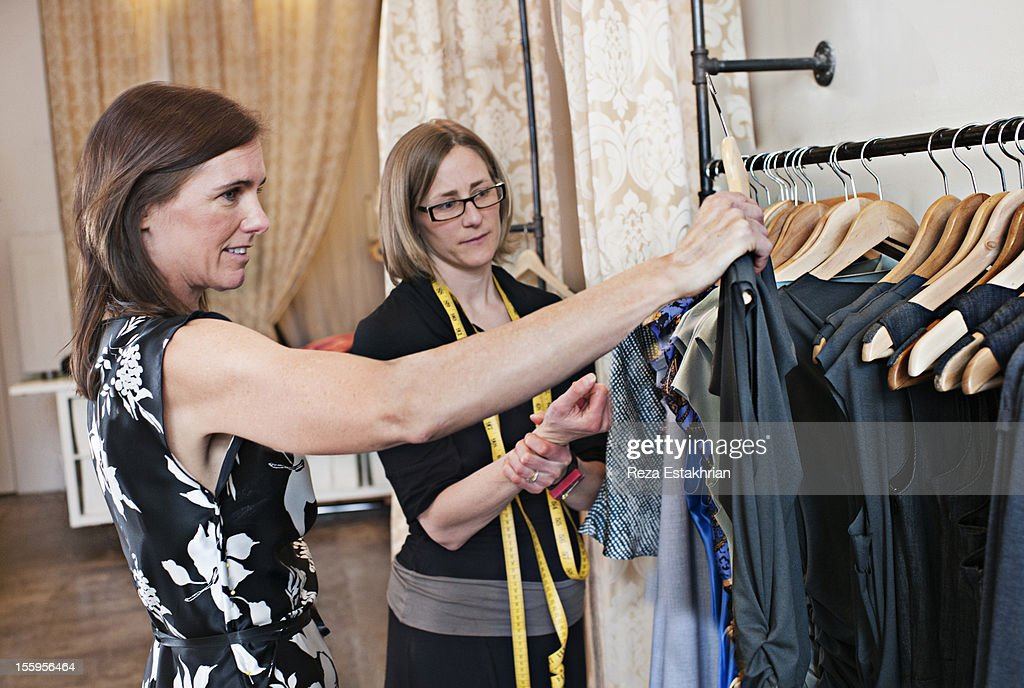 Woman shops for dress : Stock Photo