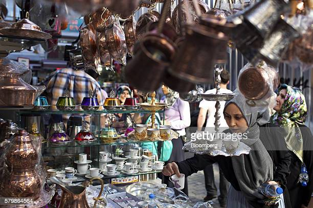 A woman shops for goods at a homewares stall in the Egyptian bazaar in Istanbul Turkey on Friday July 22 2016 Aiming to limit the economic fallout...