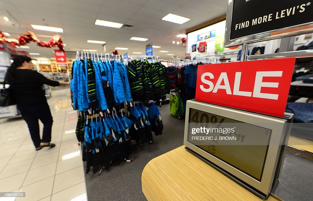 A woman shops for jewellery at a Kohl's department store which opened at 5am a day after Christmas on December 26 2013 in Alhambra California in an...