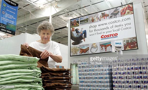 A woman shops for pants in a Costco Wholesale store May 31 2006 in Mount Prospect Illinois Thirdquarter earnings reported today were up at Costco the...