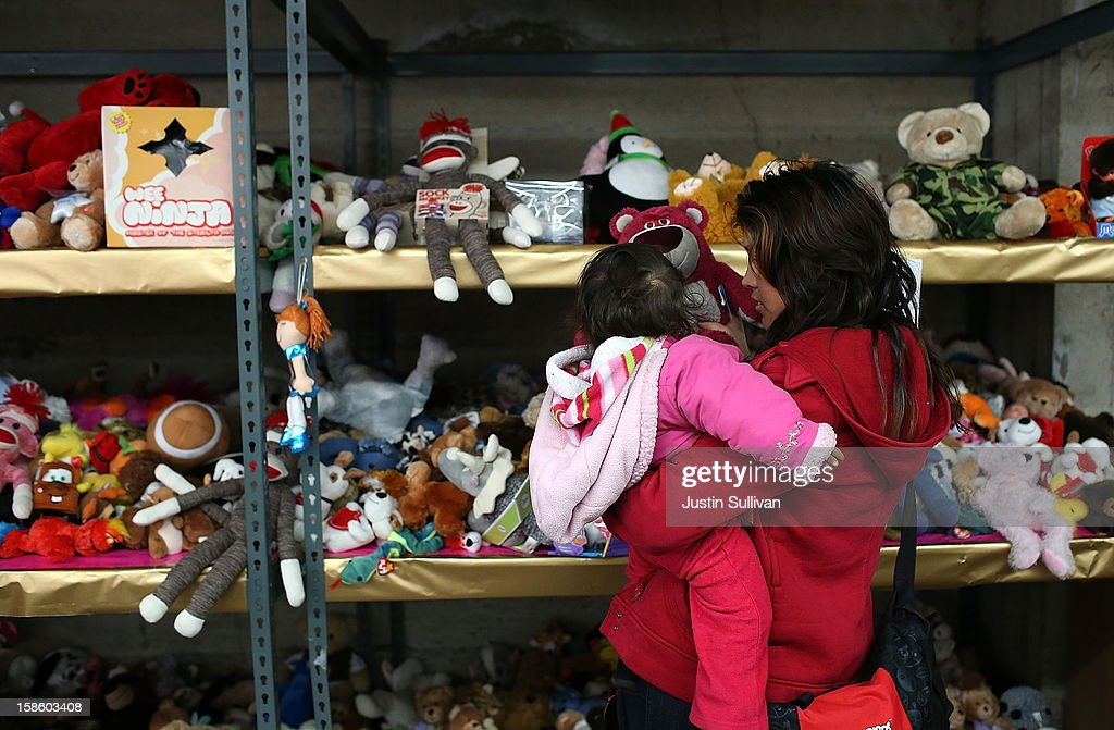 A woman shops for toys with her child during the Salvation Army's Toy & Joy Shop Distribution on December 20, 2012 in San Francisco, California. With less than one week before Christmas, the Salvation Army's Golden State division held a Toy & Joy Shop Distribution event that allows families in need to shop for free toys and receive a bag with ingredients to make a holiday meal. Nearly 1,500 families will attend the two day event.
