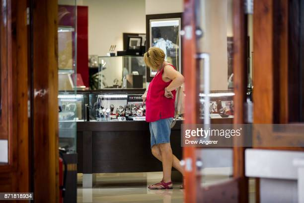 A woman shops in a highend watch store along the commercial and retail district on Front Street November 8 2017 in Hamilton Bermuda In series of...