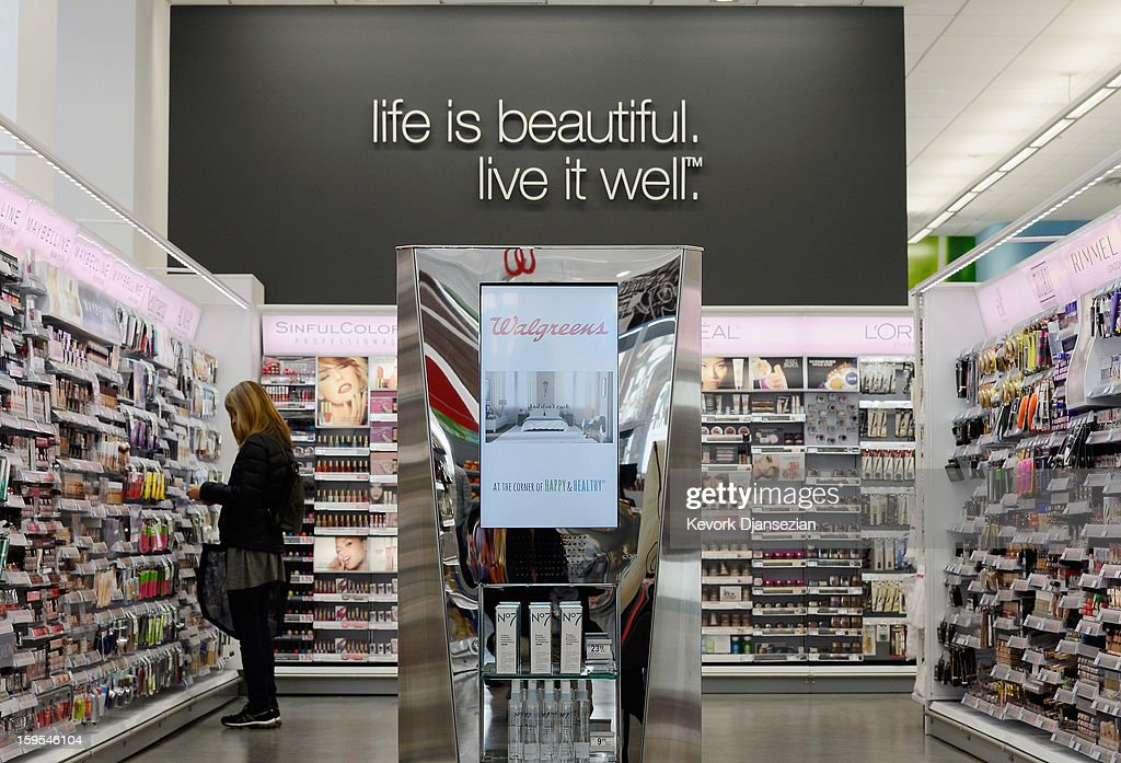 A woman shops in a new Walgreens at the corner of Sunset and Vine on January 15, 2013 in Hollywood, California. The new 23,500-square-foot, drugstore, the company's 8,000th store and first West Coast flagship, includes high-end cosmetic, skinand hair care brands, a frozen yogurt station, a fresh sushi bar, a coffee and espresso bar, a juice and smoothie bar, a wine and spirits shop with a and a virtual bartender kiosk and a cigar humidor.