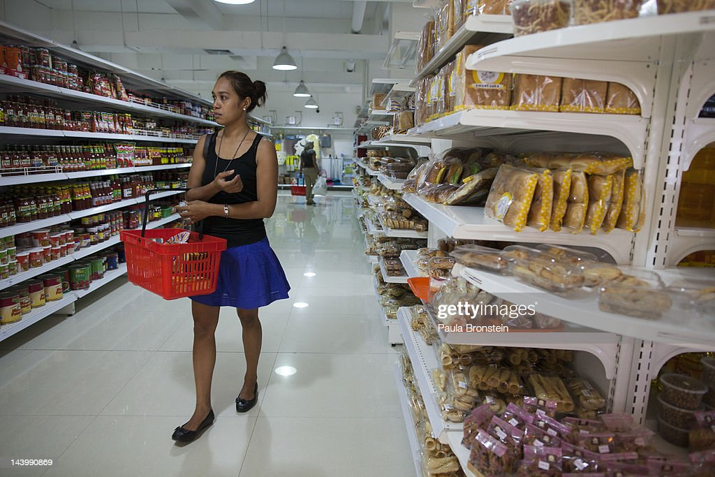 A woman shops in a supermarket inside the new Timor Plaza mall April 20 2012 in Dili East Timor Millions have been spent on aid during the first 10...