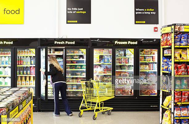 A woman shops in the fresh and frozen food aisle of a Dollar General Corp store in Saddle Brook New Jersey US on Saturday Dec 3 2011 Dollar General...