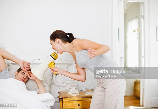 Woman shouting at husband with bullhorn
