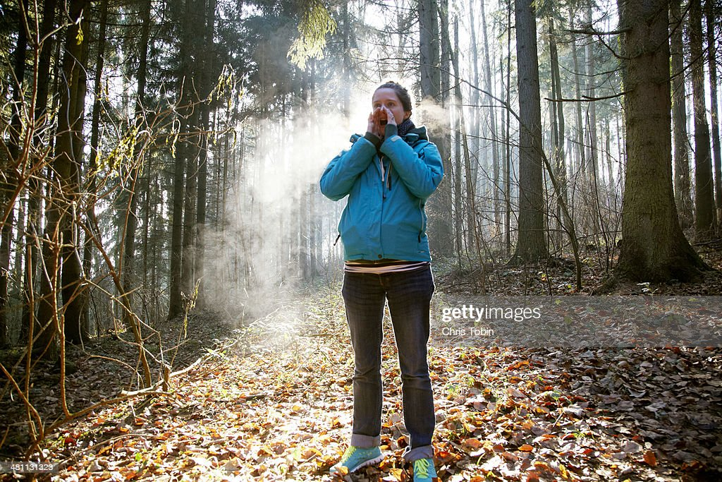 Woman shouting in forest : Stock Photo