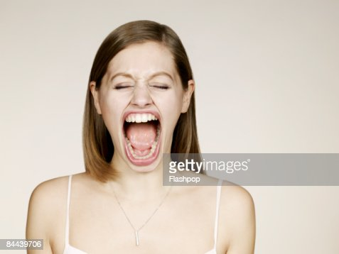 Woman shouting with big mouth