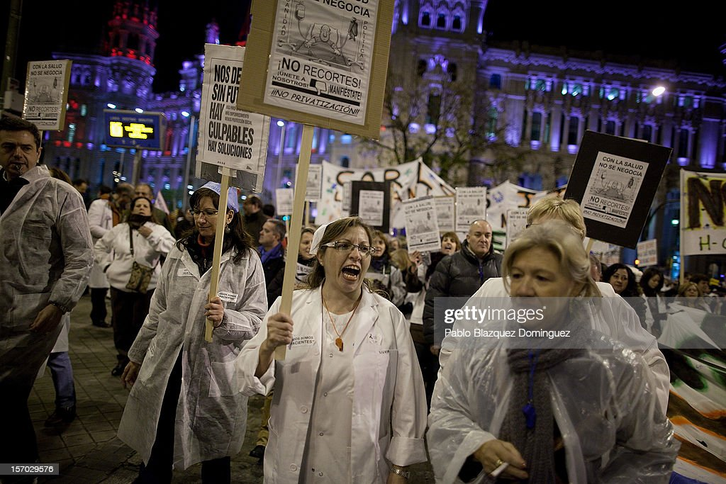 A woman shouts amid other health workers during a demonstration held on the second day of a two day general strike on November 27, 2012 in Madrid, Spain. For the first time all trade unions called for a 48-hour general health workers strike in the Madrid region after the regional government announced severe cuts and privatization of medical centers.