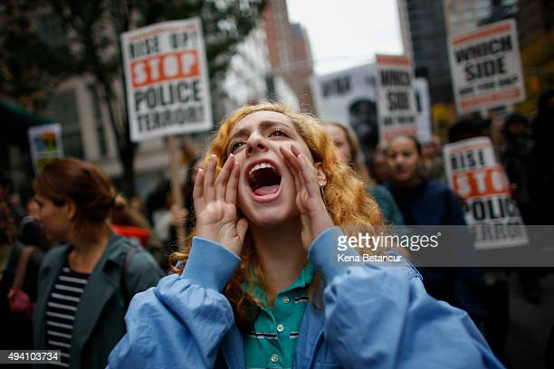 A woman shouts slogans as she attends a protest to denounce police brutality in Manhattan October 24 2015 in New York City The rally is part of a...