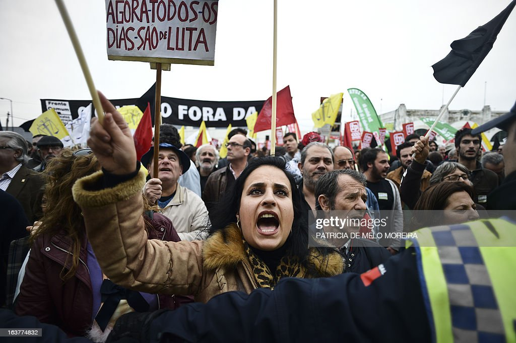 A woman shouts slogans as she protests with thousands of demonstrators during a demonstration called by the unions Common Front, CGTP (General Confederation of the Portuguese Workers) and STAL (National Union of the Local and Regional Public Workers) against the austerity measures of the Portuguese government in Lisbon on March 15, 2013. Today the Finance Minister, Vitor Gaspar, said that the GDP (Gross Domestic Product) will drop 2.3%, that unemployment might reach 19% and the adjustment effort will have to continue for decades.' AFP PHOTO/ PATRICIA DE MELO MOREIRA