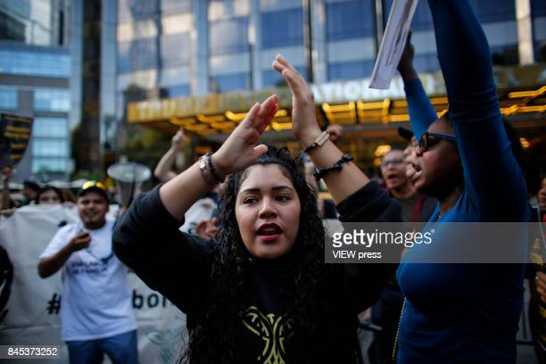 A woman shouts slogans as she takes part during a march in protest of President Trump's decision on DACA in front of a Trump Hotel on September 9...