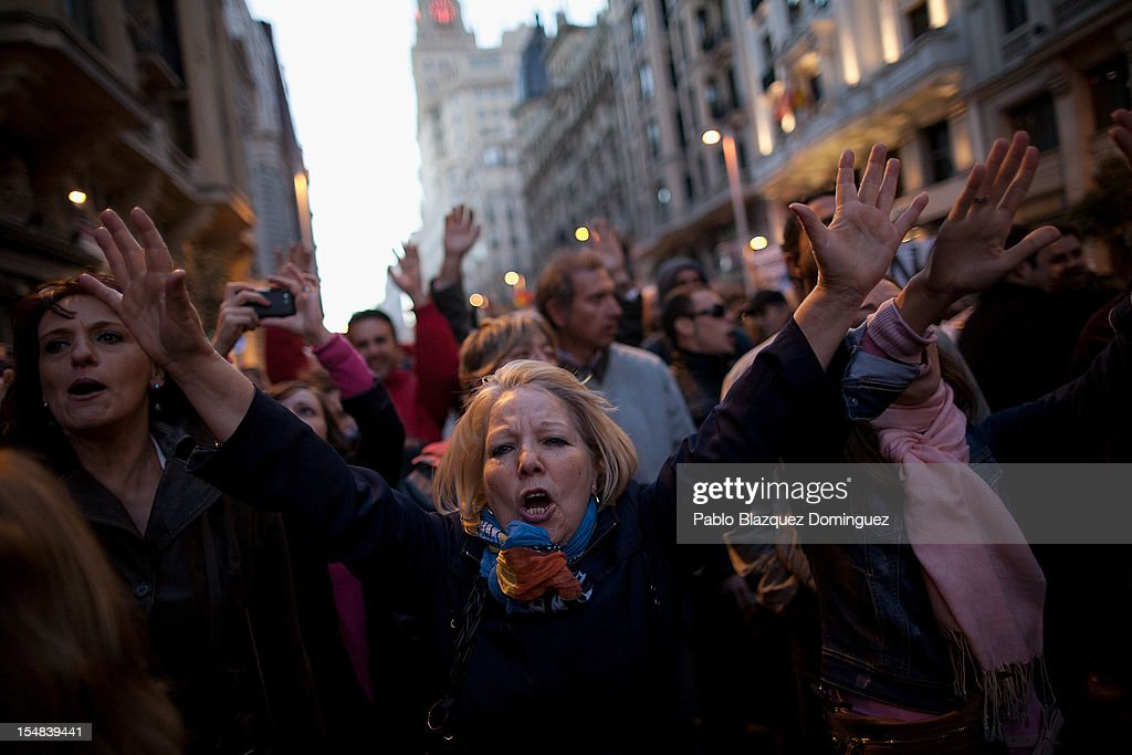 A woman shouts slogans during a protest against spending cuts and the government of Mariano Rajoy on October 27, 2012 in Madrid, Spain. Demonstrators are protesting near the Spanish Parliament against the government's austerity measures. With the economic crisis tightening it's grip, Spain is in its second recession in three years, Rajoy's governement is presssured more and more to seek aid that can easy their debts.