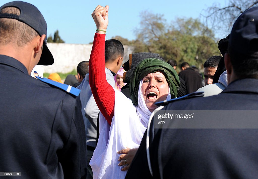 A woman shouts slogans in support of Sahrawis during a demonstration outside a court in Rabat on February 8, 2013. Rival protests were held outside a military tribunal in the Moroccan capital where 24 Sahrawis accused of killing members of the security forces in the Western Sahara in 2010 are being tried.