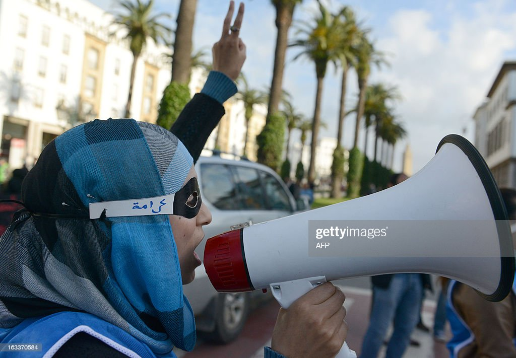 A woman shouts slogans through a megaphone as Moroccan women demonstrate during the celebration of the International Women's Day on March 8, 2013, in Rabat. The International Women's Day is marked on March 8 every year. AFP PHOTO/FADEL SENNA