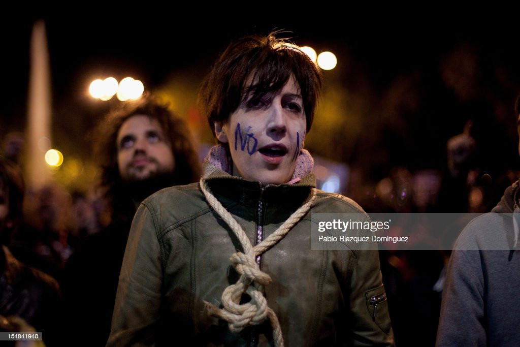 A woman shouts slogans wearing a rope around the neck during a protest against spending cuts and the government of Mariano Rajoy on October 27, 2012 in Madrid, Spain. Demonstrators are protesting near the Spanish Parliament against the austerity measures of Spanish Prime Minister Mariano Rajoy's governmnet. Spain is in its second recession in three years and Rajoy's governement is increasingly presssured ino seeking aid that can ease their debts.