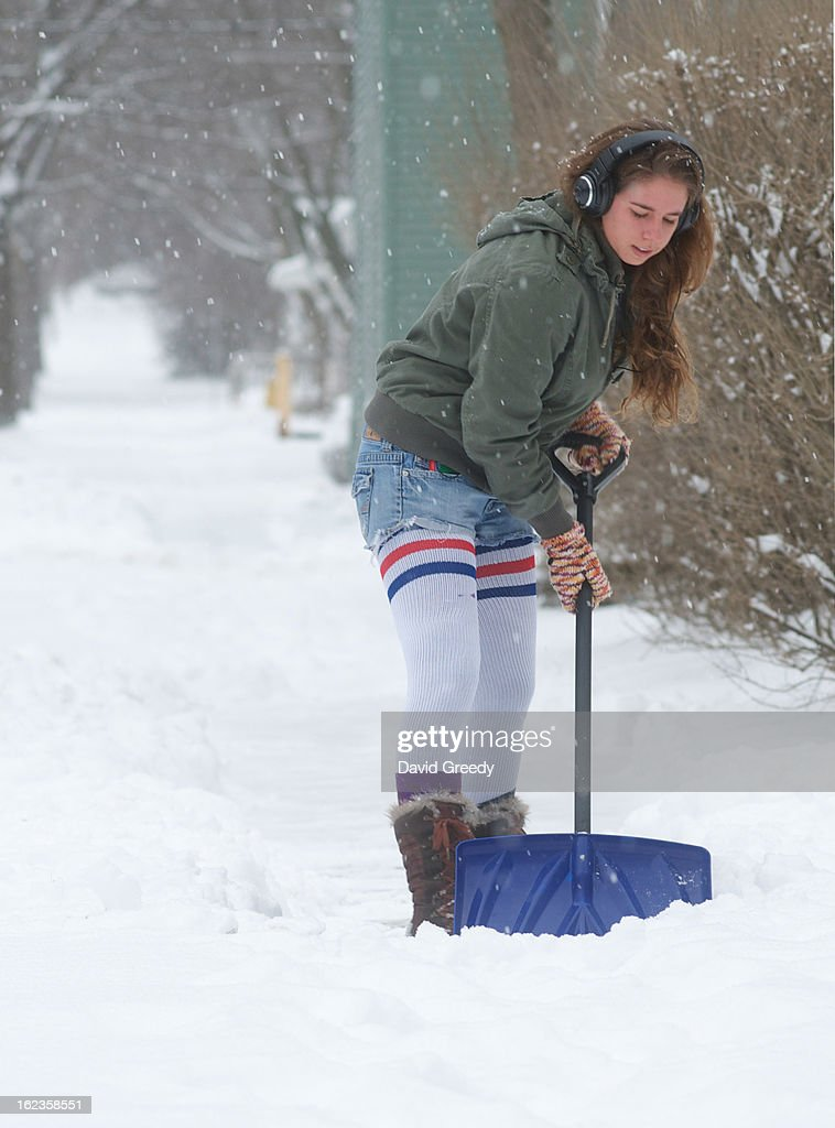 A woman shovels after a winter storm left more than six inches of snow on February 22, 2013 in Iowa City, Iowa. The winter blizzard continues to move across the entire midwest, dumping up to a foot of snow in places as it moves east.