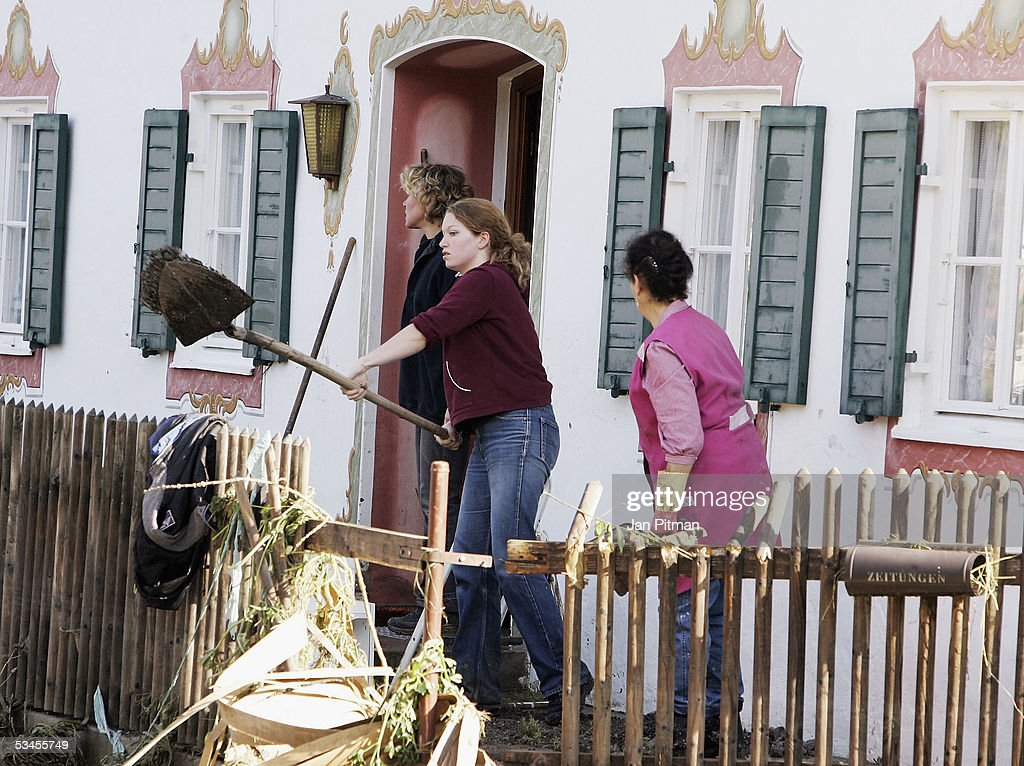 A woman shovels mud outside of a house on August 24, 2005 in Eschenlohe, Germany. People in southern Bavaria are cleaning up the streets and their houses now the water levels in the rivers are dropping. Southern Bavaria was hit with the worst flooding in five-years leaving several towns isolated from the outside world.