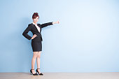 business woman is smile and show something to you with blue background, asian