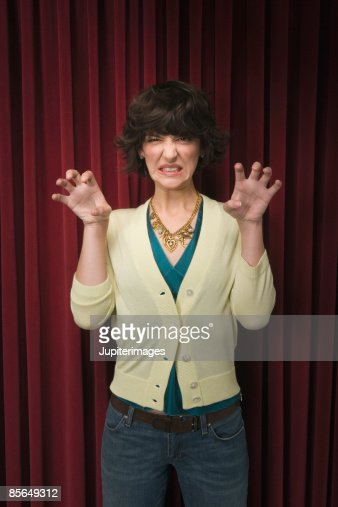 Woman showing claws on stage