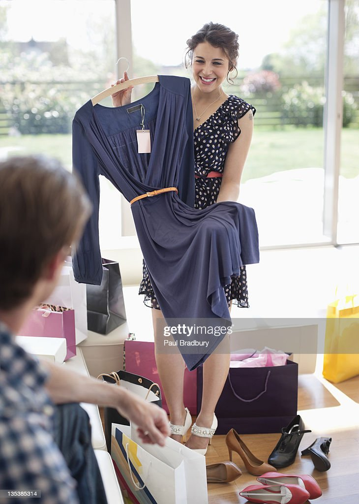 Woman showing dress to husband : Stock Photo
