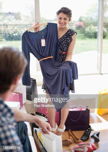 Woman showing dress to husband : Stockfoto