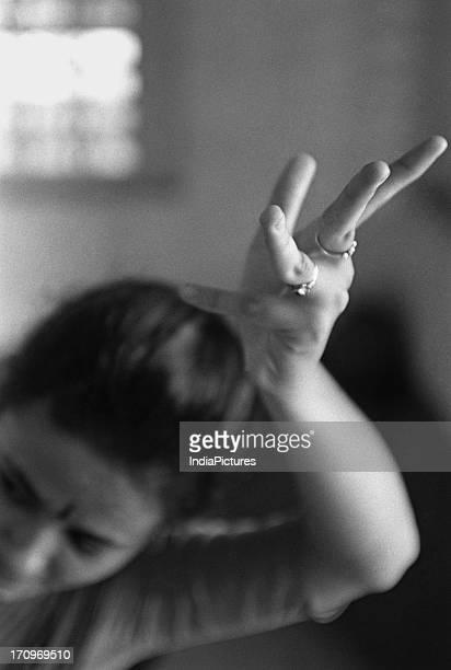 A woman showing hand movement Dance Chennai Tamil Nadu India