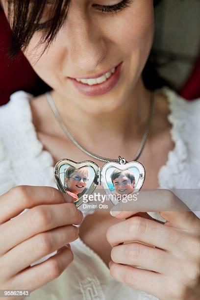 woman showing her children in locket