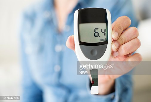 Woman Showing Her Glucose Level Test.