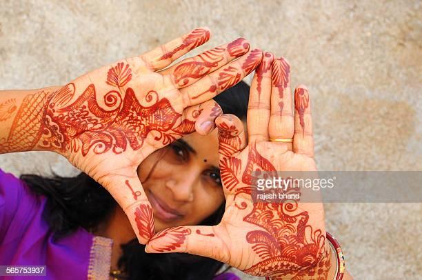 Woman showing her mehndi design