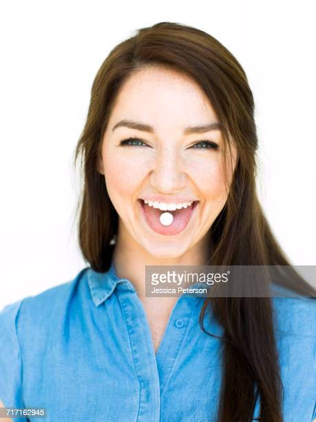 Woman showing mint on tongue