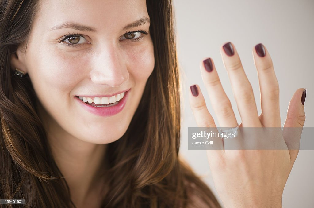 Woman showing off engagement ring : Stock Photo