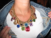 Woman showing off her colourful gem necklace