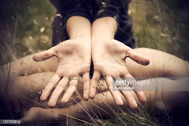 Woman showing open palms