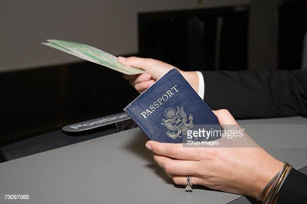 Woman showing passport and airplane ticket
