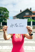 Unrecognizable young woman showing poster with metoo hashtag