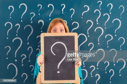 Woman Showing Question Mark on Blackboard : Stock Photo