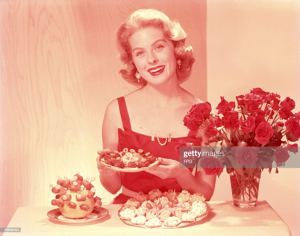 Woman showing selection of hor d'oeuvres, portrait : Stock Photo