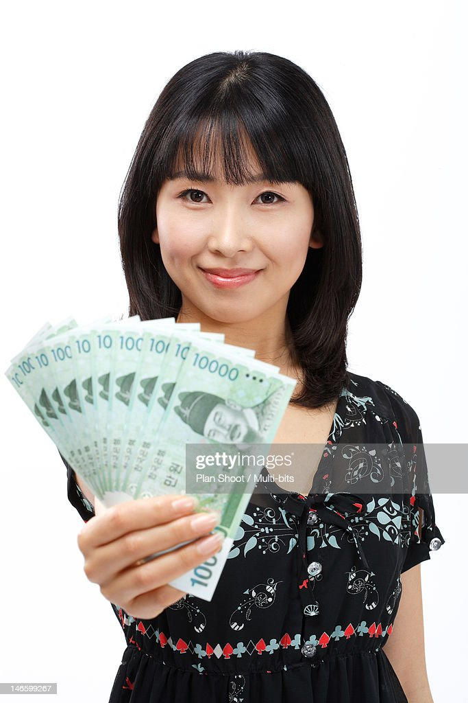 Woman showing South Korean currency : Stock Photo