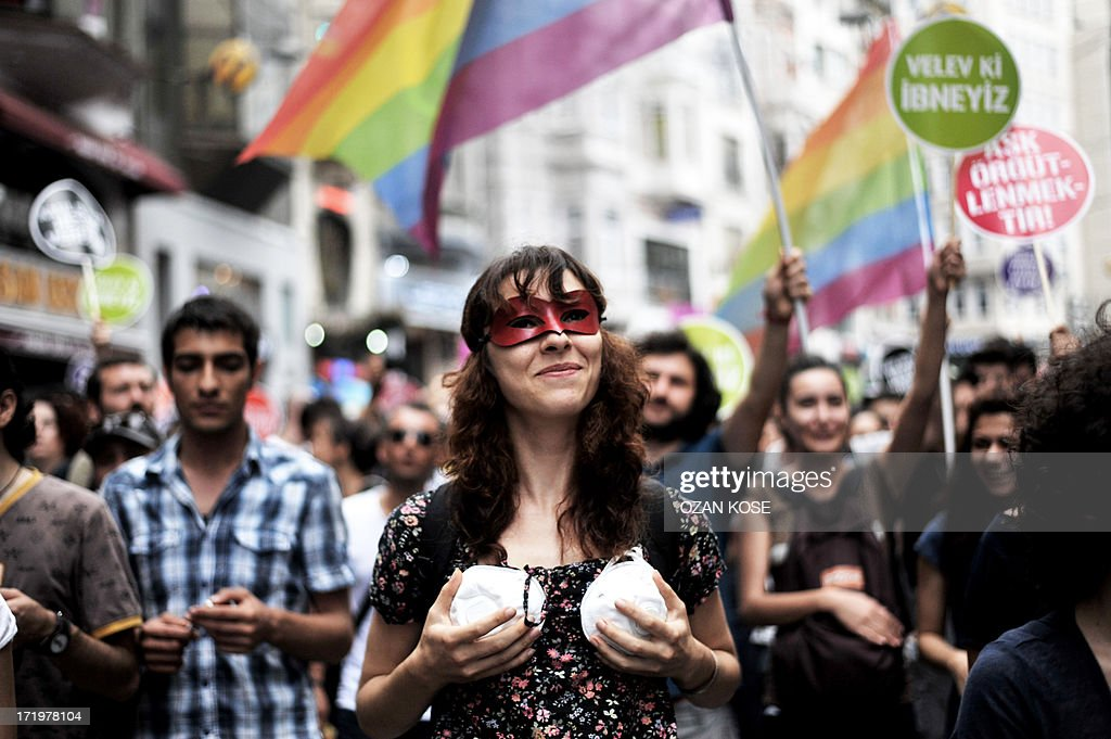 A woman shows a bra made from a gas mask during during a gay parade on Istiklal Street, the main shopping corridor on June 30, 2013 in Istanbul during the fourth Trans Pride Parade as part of the Trans Pride Week 2013, which is organized by Istanbul's 'Lesbians, Gays, Bisexuals, Transvestites and Transsexuals' (LGBTT) solidarity organization.