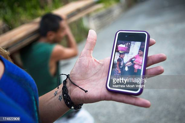 A woman shows a photo taken from her phone