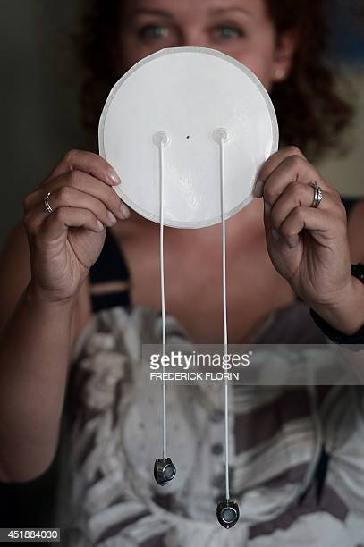 A woman shows a prototype of a Defymed bioartificial pancreas at the European Center for the Study of Diabetes on July 3 2014 in Strasbourg eastern...