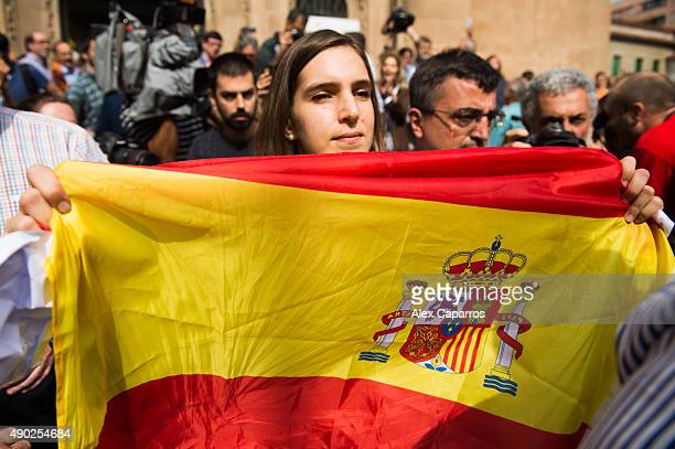 A woman shows a Spanish flag after leader of Catalan Democratic Convergence 'Convergencia Democratica de Catalunya' party Artur Mas casted his vote...